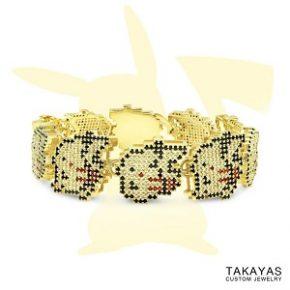 Bracelete de ouro e safira com detalhes inspirados em Pikachu