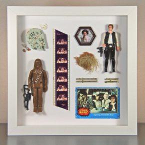 Pequenos quadros com adereços antigos de Star Wars